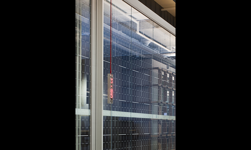 """A workplace wayfinding and environmental graphics system designed to reflect the idea """"Testing Grounds."""" Custom metric glazing graphic allows users to produce scale sketches while using meeting rooms. (image: office window with LED sign)"""