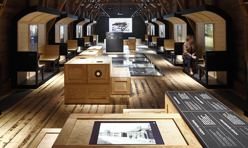 """Diminutively nicknamed """"Banitis"""" in Latvian, this little train has inspired a treasure trove of local residents' personal stories. (image: exhibit space, filled with wooden-box exhibits)"""