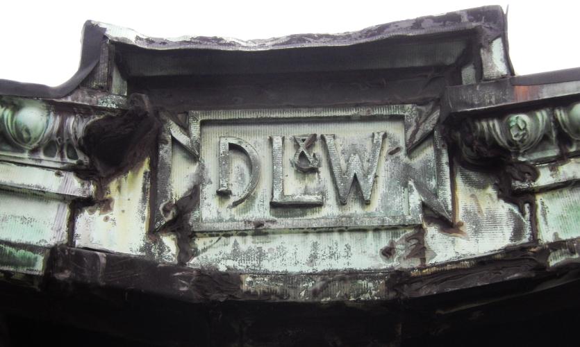 Logo of the Delaware, Lackawanna & Western Railroad—DLW—Lance Wyman's namesake. Notice the D is formed by a railroad spike.