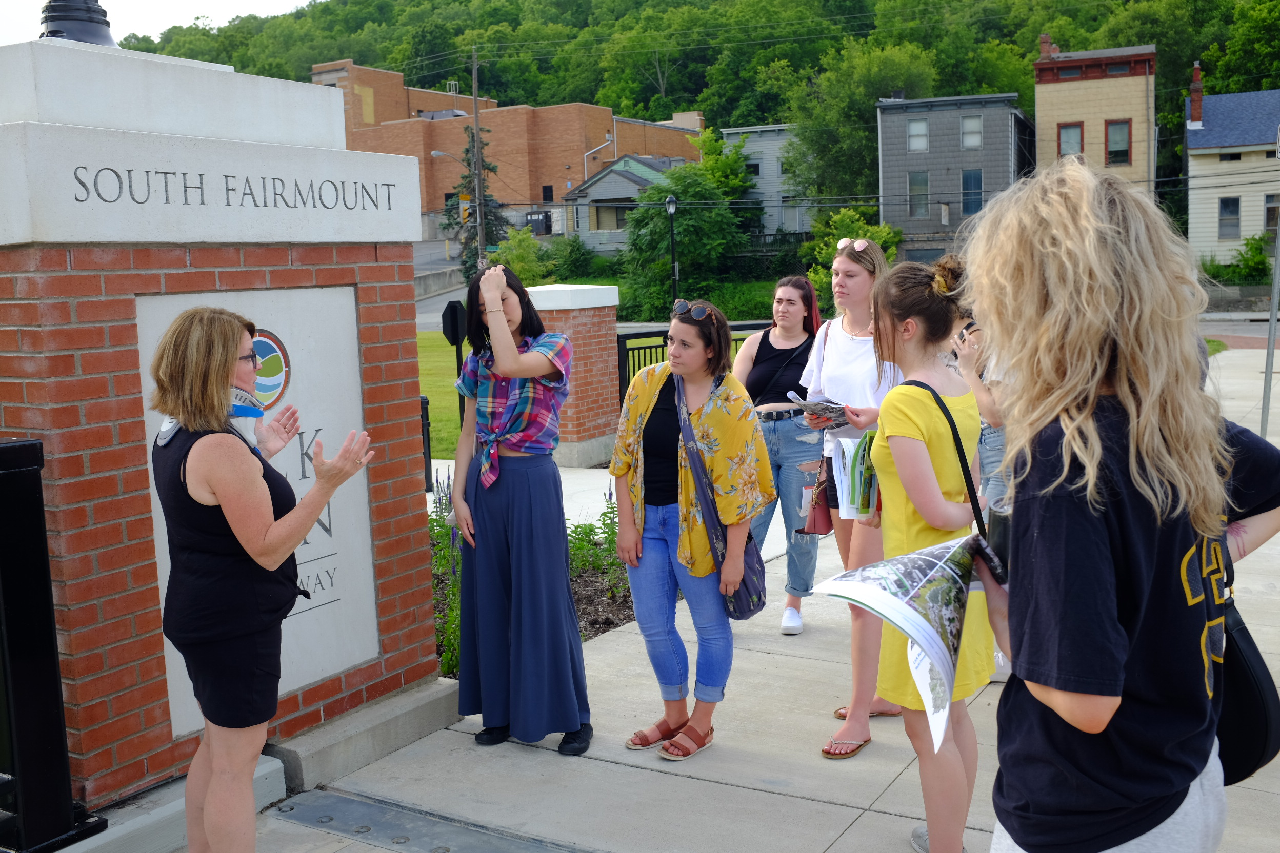 Tour group viewing a gateway feature.