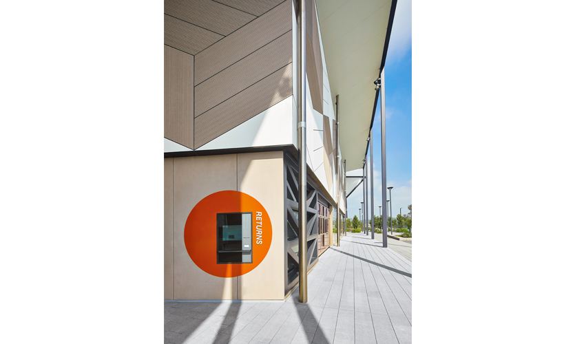 Together with the interiors, signage and large-scale environmental graphics in the building needed to be just as compelling as the exterior façade. (image: book return slot)