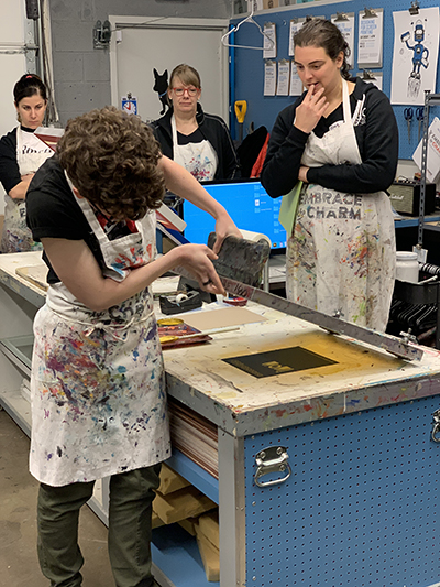 Screen printing with Ink Lounge at SEGD Denver's workshop.