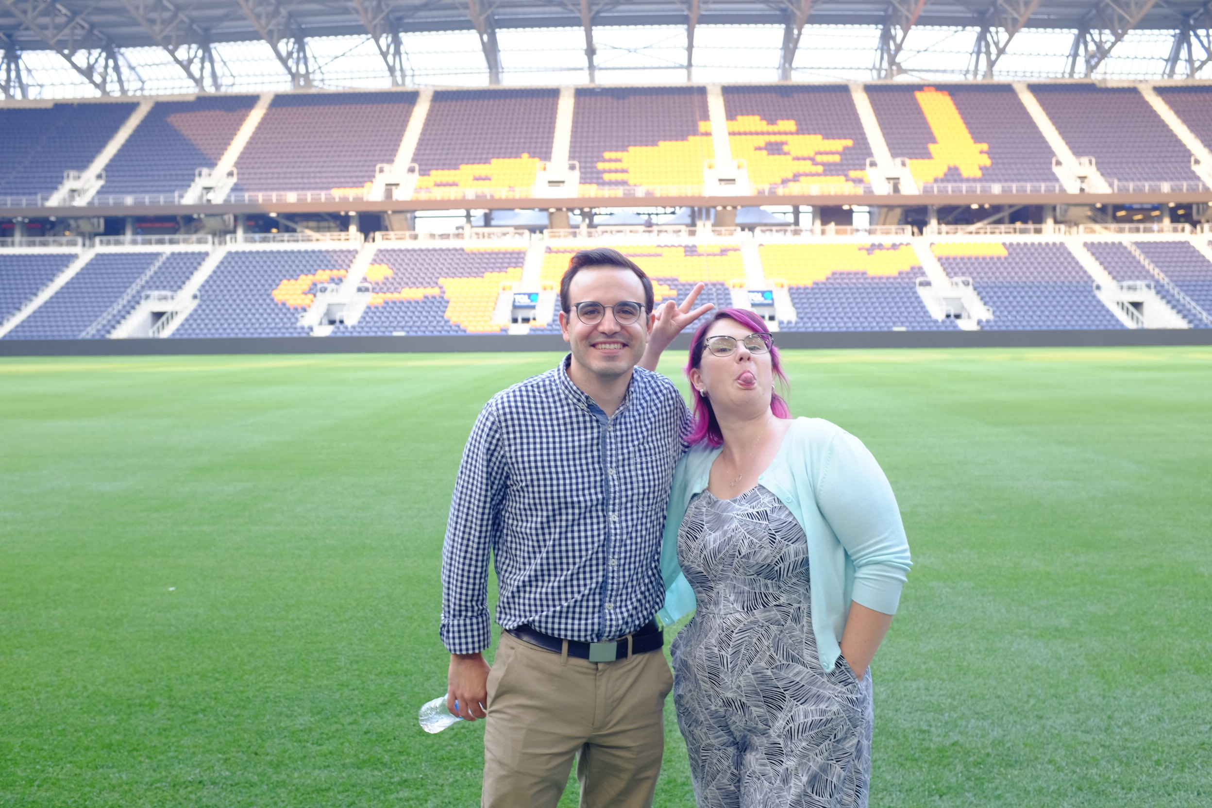 Tour leaders Nick and Jemma on the pitch.