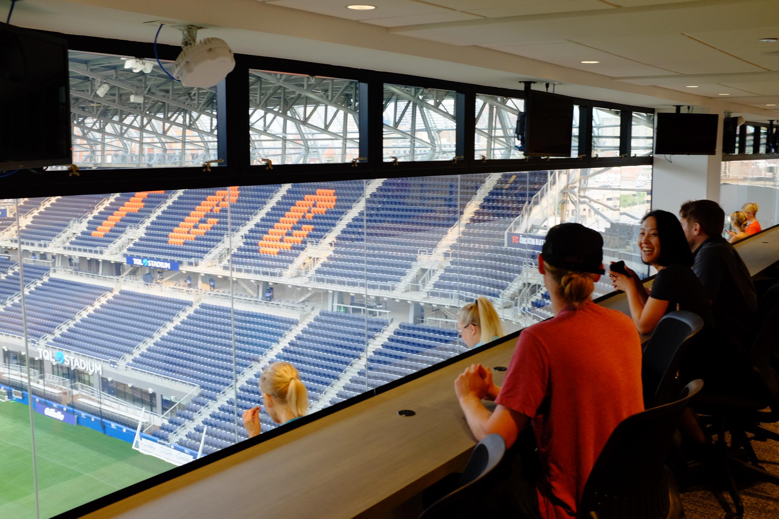 Tour group seated in stadium press box