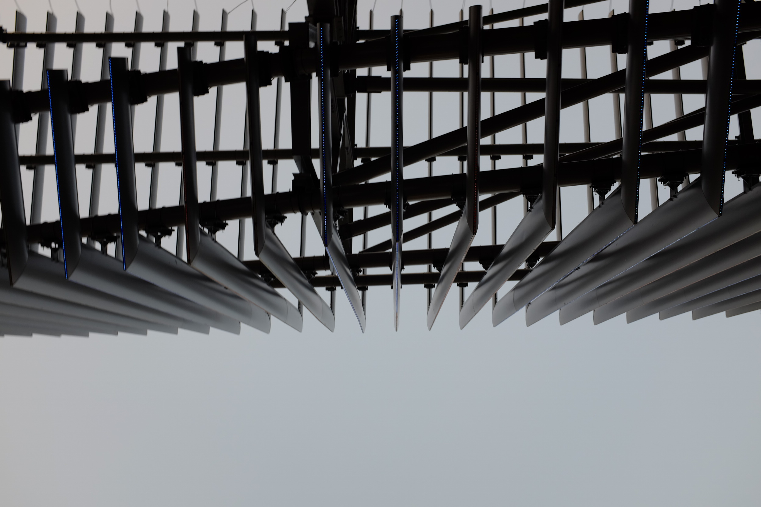 Looking up at LED fins on the outer structure of the stadium.