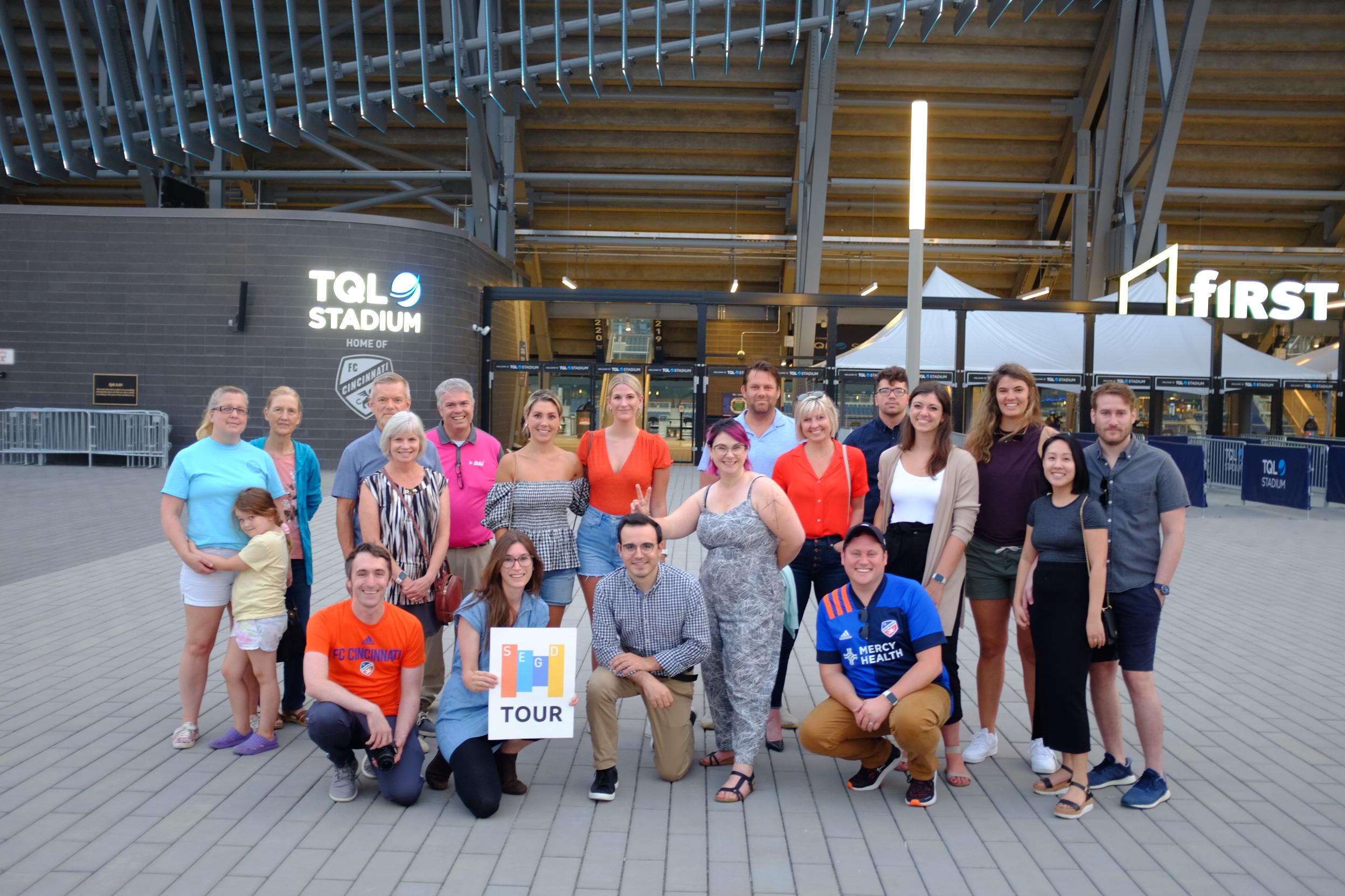 Group photo of SEGD Cincinnati tour in front of TQL Stadium