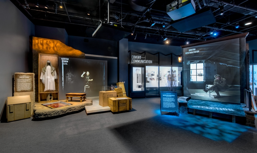 People begin their undercover mission in the Spies and Spy Masters Gallery where theatrical vignettes and walls of trade tools bring human intelligence stories to life. (image: gallery with thematic scenes)