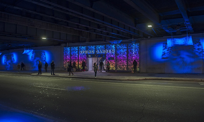 A busy transit hub entrance in an underpass on Spring Garden Street in Philadelphia receives a dramatic and illuminating makeover.