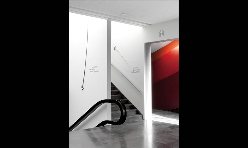 Wayfinding Arrows on Stairwell Walls, Design Museum Holon Signage and Wayfinding, Adi Stern Design