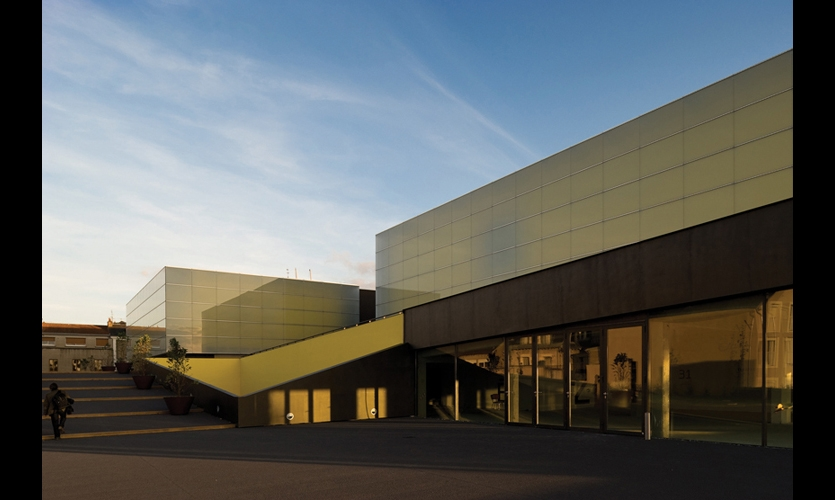 The contemporary Theatre and Auditorium of Poitiers (TAP) contrasts sharply with its surroundings in an ancient city known for its medieval architecture.