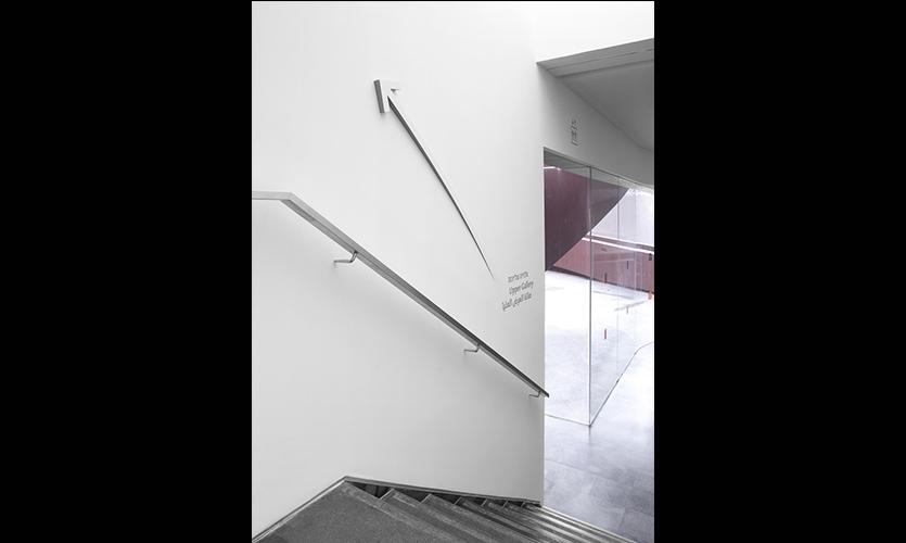 Wayfinding Arrow on Stairwell Wall, Design Museum Holon Signage and Wayfinding, Adi Stern Design