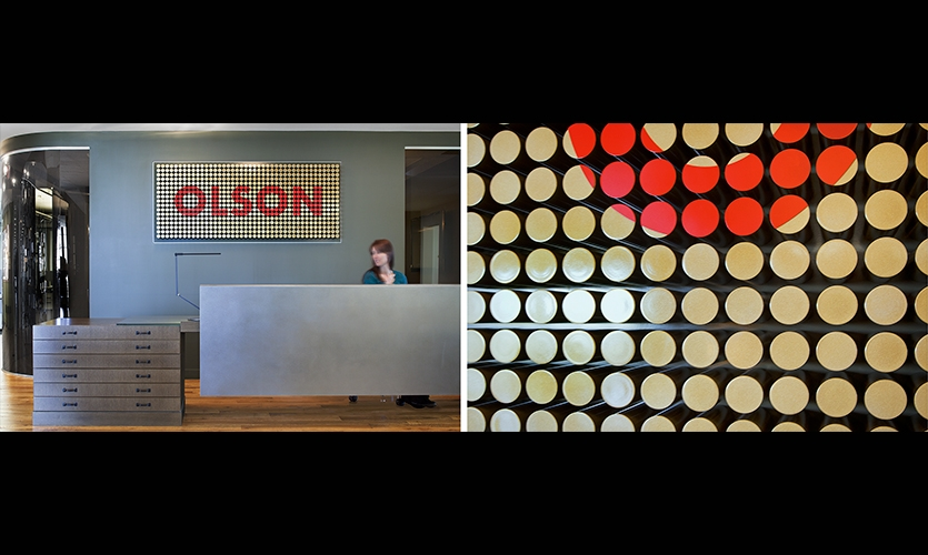 In the 10th floor entryway, a dimensional logo wall s made from hundreds of bronze tubes.