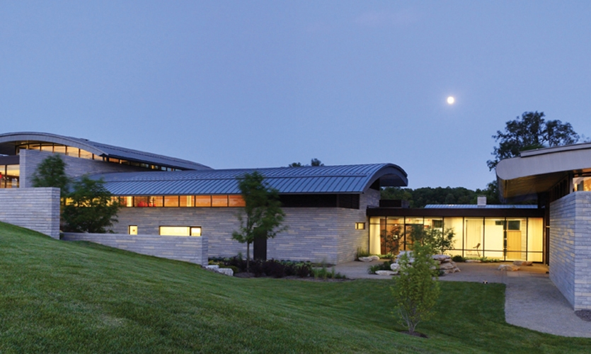 The $30 million Aileron center for entrepreneurial education, outside Dayton, Ohio, seems to hover over the surrounding farmland. Signature zinc-clad, wing-inspired roof forms are part of the design vocabulary that infuses all aspects of the campus. (Photo: Alan Karchmer)