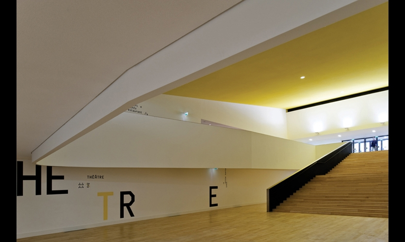 """Inside the center, vast expanses of wall cried out for color and bold graphics. Yellow adds a """"warm vibration"""" and offsets superscaled graphics."""