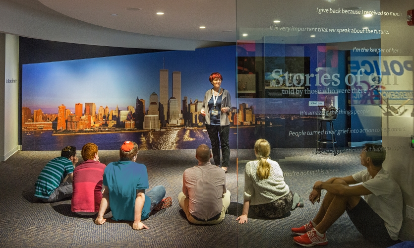 The storytelling area allows visitors to learn from and interact with survivors who share their stories.
