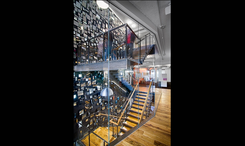 An eclectic collection of images and objects adorns the stairwells.