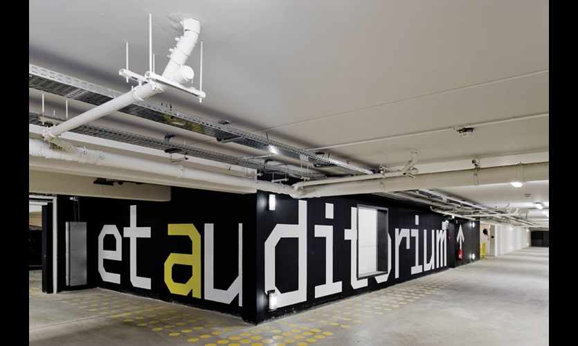 In the public parking garage, huge-scaled graphics point the way to the auditorium. P-06 chose BS Monofaked type, created by Portuguese designer Mário Feliciano, for its simple lines and scalability.