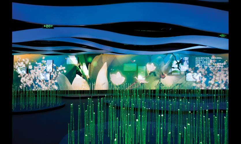 A layered landscape of digital screens and projected images engage visitors as they walk along the Dreamers Path, showing the change of seasons.