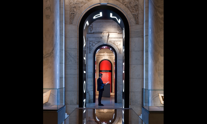 "The exhibit celebrated the library's historic architecture with a contemporary flair, embedding LED-illuminated ""portals"" into iconic archways."