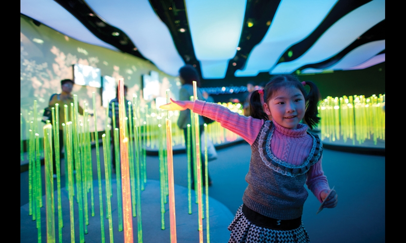 A meadow of LED rods responds to visitors as they approach and wave.