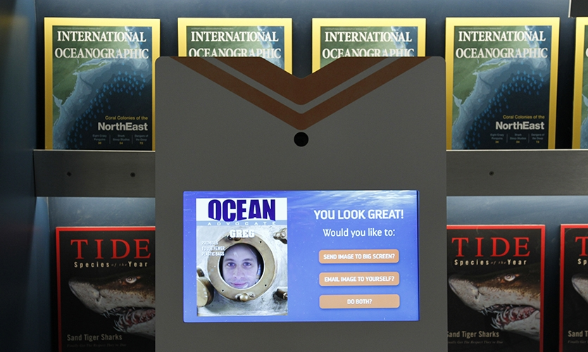 The newsstand enables guests to design a magazine cover with their selfie and ocean conservation pledge on a large display for future aquarium guests.