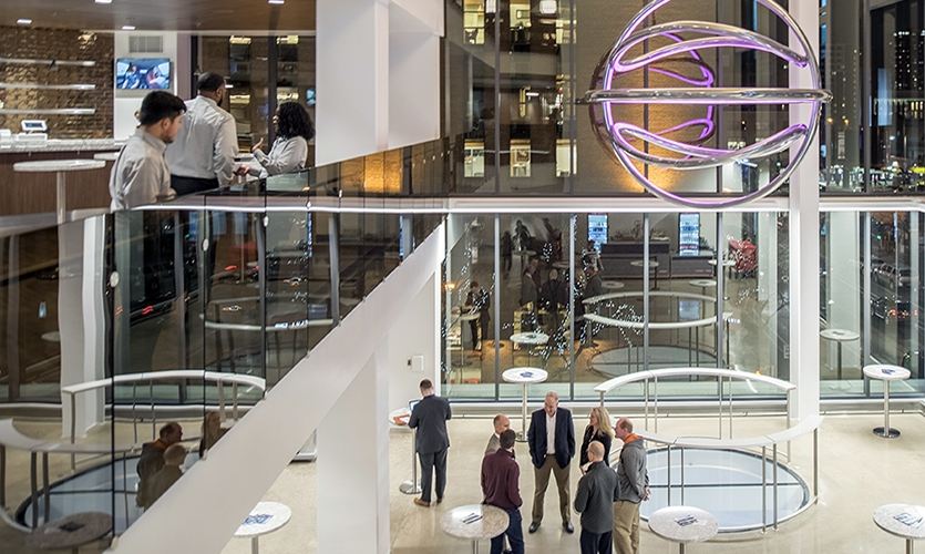 The big show-stopping beacon the client team wanted to connect the upper and lower levels of the atrium and the interior to the exterior cityscape manifested in the form of a ball and net.