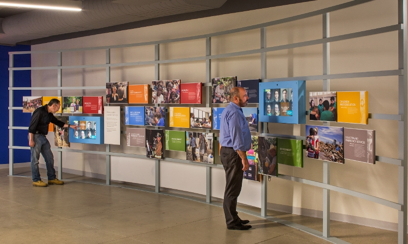 The media wall draws data from a nearby photo station kiosk where visitors can record their personal contribution or pledge.
