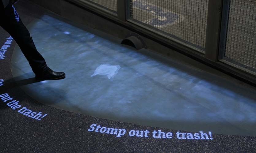 A projection interactive allows guests to stomp out plastics in the ocean.