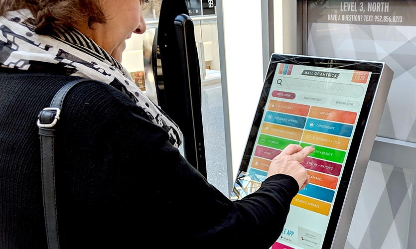 Interactive kiosks at the Mall of America were just the first step of many to enhance the user experience at the largest mall in North America. (Image: woman using digital touchscreen, courtesy of Greg Hoffman.)