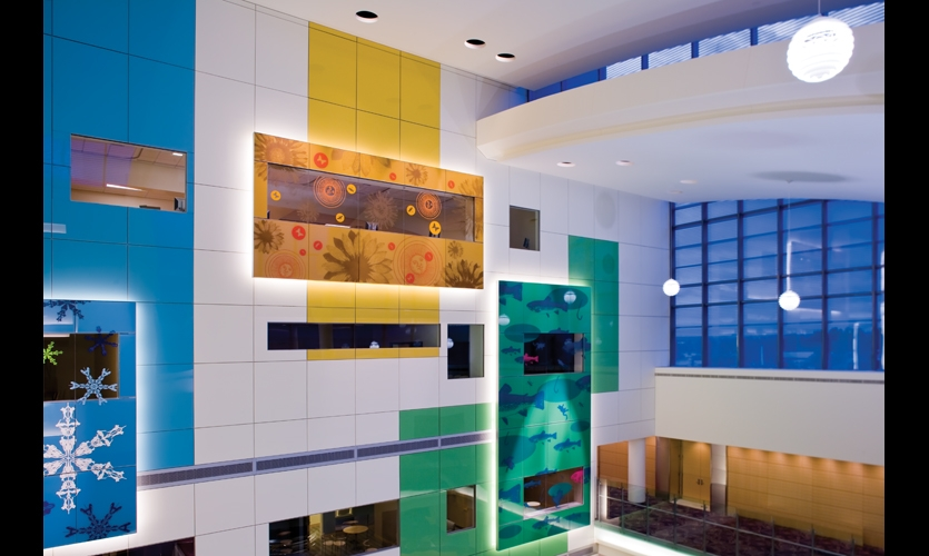At Children's Hospital Fitzsimons (Aurora, Colo.), 13,000 sq. ft. of layered glass panels were imaged with colorful animal and nature imagery. (Art: Larry Kirkland. Fabrication: Skyline Design. Photo: Jackie Shumaker Photography)