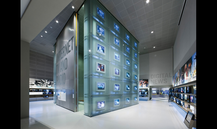 The Media Tower in the Internet, TV, and Radio Gallery features 48 analog TV screens encased in a floor-to-ceiling glass-and-steel box.