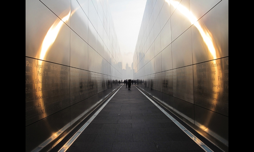At dusk and dawn, an otherworldly halo effect touches the names engraved on the New Jersey 9/11 Memorial. (Photo: Frederic Schwartz Architects)