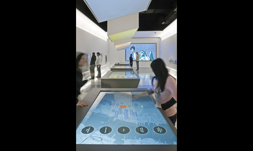 Interactive map tables allow visitors to explore the city in depth and plan customized journeys. (Photo: Albert Vecerka/Esto)