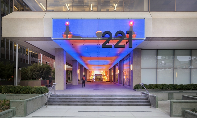 The digital façade at 221 Main Street is an integrated architectural element that reflects the dynamic nature of the neighborhood.