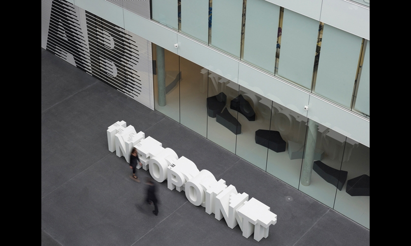 In the Adidas center entry, typography is sculpture and directory. Uebele also created superscaled department identifiers incorporated into screens made of slender metal tubing. They can be seen from all points in the atrium. (Photos: Christian Richters, Werner Huthmacher)