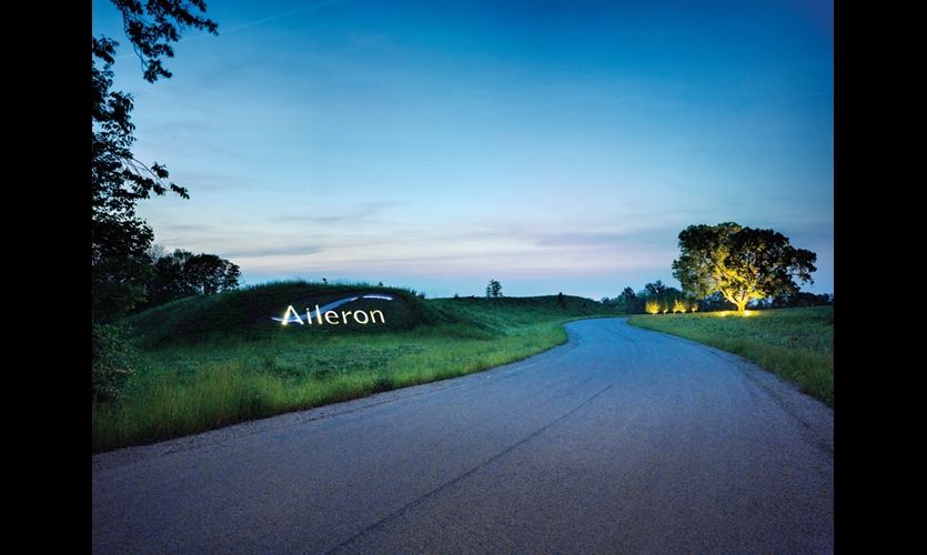 Along the winding road to the Aileron entrance, Skolnick embedded the Aileron marquee--11-inch-deep, LED-lit stainless steel letters--in a grassy knoll. (Photo: Ryan Kurtz)