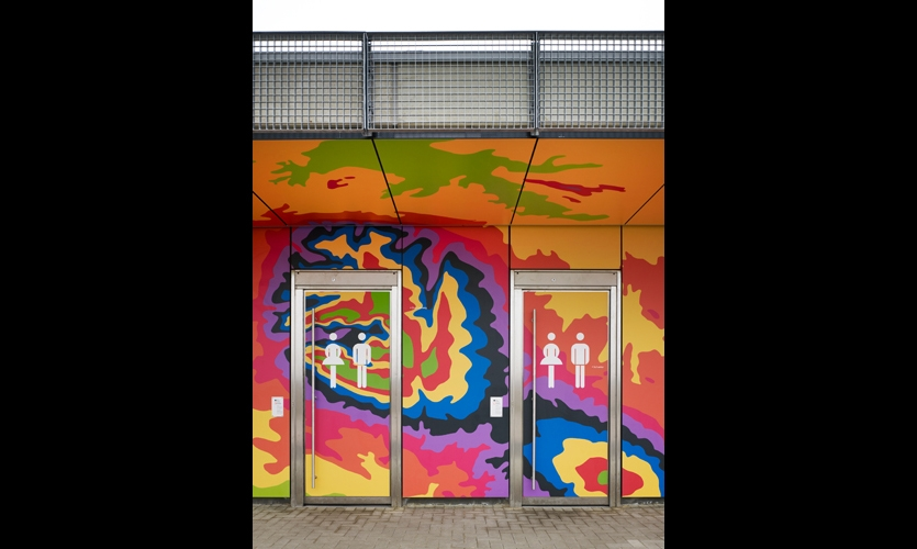 Bright laminate panels make graffiti redundant. The panels feature digital imagery of the landscape visualized as a map, reflecting the topography of the area with different colors for each altitude level. (Photos: Christian Richters)
