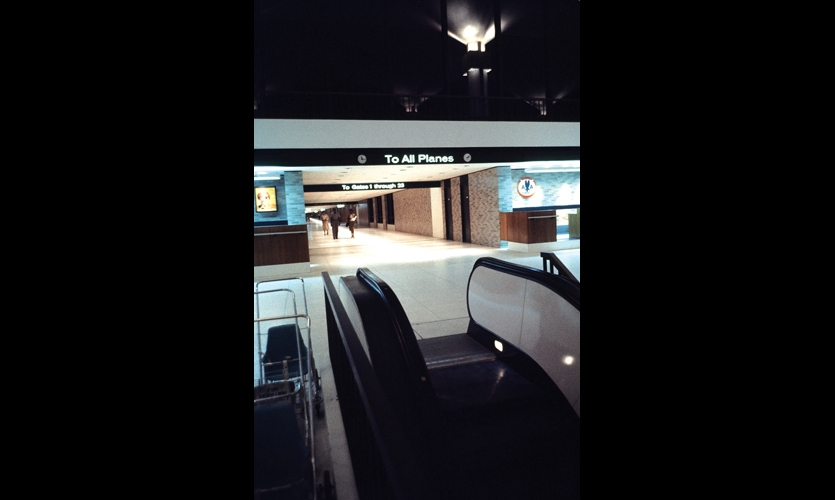 "At Memphis International Airport, Doggett created a new airport aesthetic: signs built into the architecture, ""not hanging like price tags and labels."" All messages, including airline titles, were standardized in one font and contained in fascia bands and in beams spanning corridors, à la the Greek classical frieze."