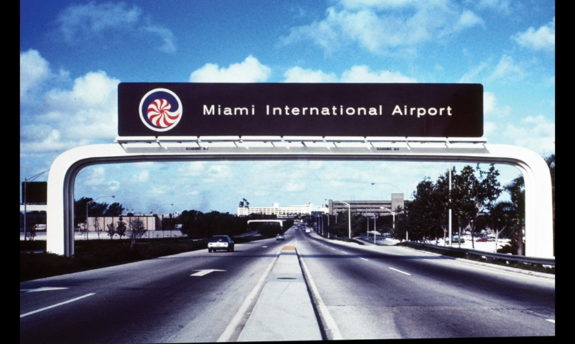 Doggett is also credited with the concept of thematic graphics to brand airports as gateways to their communities. At Miami International, her logo was based on the sea nautilus and used orange and plum—colors favored by the Latin Americans who make up a large portion of the area population. Her design vision for roadway signage was white sculptural arches inspired by the Spanish arches that typify Miami's Spanish architecture.