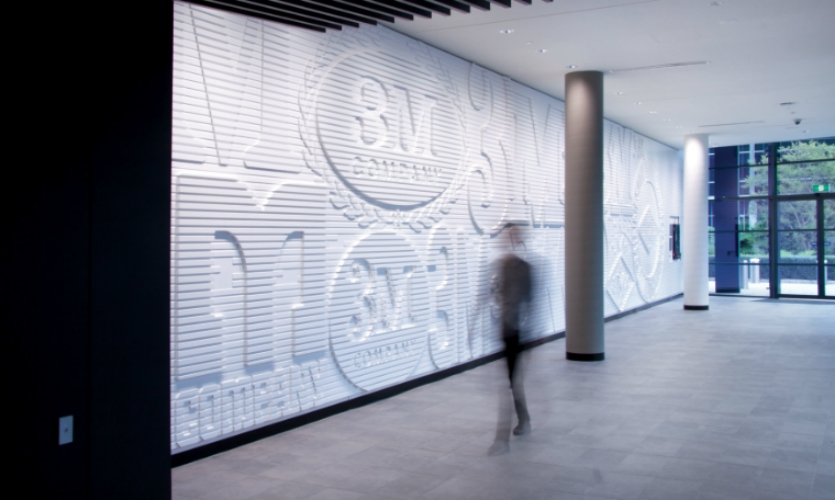 In the headquarters foyer, they created a dimensional, 80m2 heritage wall depicting 3M's history and innovations through the evolution of its logo.
