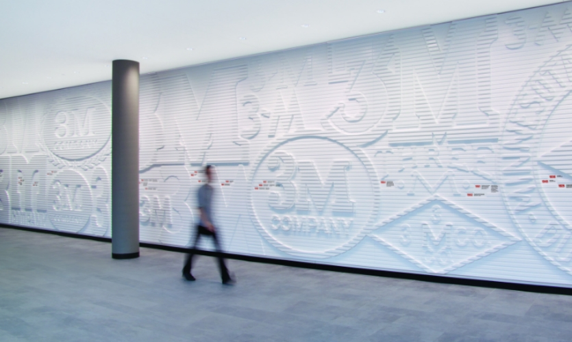 The wall was finished in white to contrast with the shadows cast by the dimensional logos.