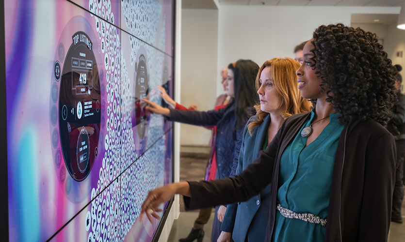 The centerpiece for the building's data visualization is a 15-foot-tall interactive touch wall, constructed of nine separate LCD displays, located in the gallery area.