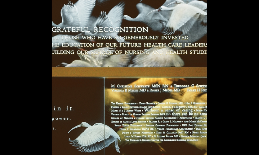 A donor tribute at the Univ. of Miami School of Nursing is layered and intricate, with two-layer, deep V-cut, hand-carved individual letters and finely etched images of the ibis, the school mascot. (Design and fabrication: Amri Studio)