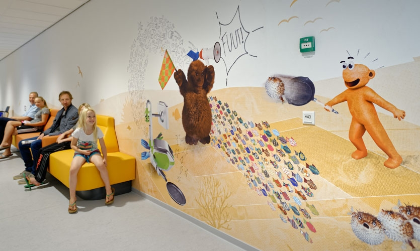 The five characters appear throughout the hospital so patients can find them during their stay—from the atrium and waiting areas to the corridors and treatment rooms
