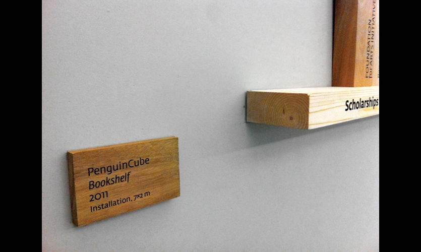 """Inspired by the rawness and simplicity of the space, the PenguinCube team opted for a basic engraving technique and a mill finish on the """"books"""" of varying sizes and woods."""
