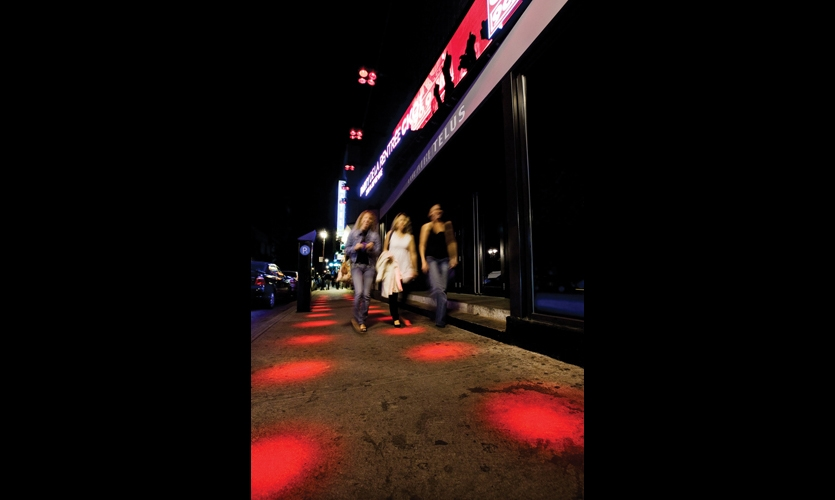 """Designers Ruedi Baur and Jean Beaudoin (Intégral), in collaboration with lighting designer Axel Morgenthaler, conceived a dynamic urban lighting plan that includes a new """"luminous pathway"""" of red dots leading to major cultural hotspots."""