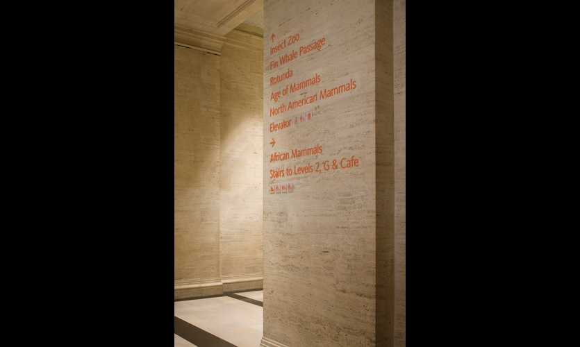 To augment the large-scale wayfinding elements, Carbone Smolan added painted dimensional letters to the travertine walls.