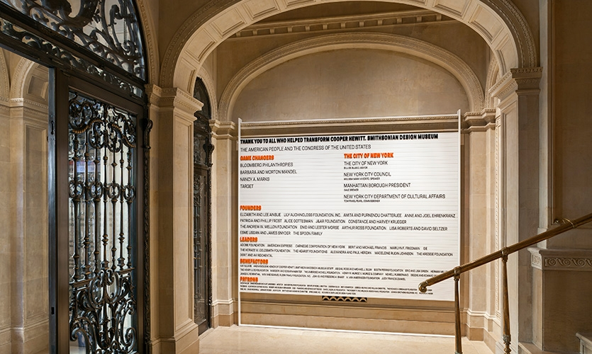The donor wall at the 91st Street entrance is carefully suspended from the landmark interior.