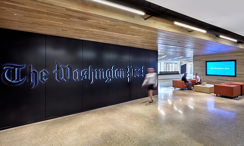 Visitors are greeted by the weathered exterior signage from previous building—a well-known D.C. landmark—creating an honest blend of old and new.