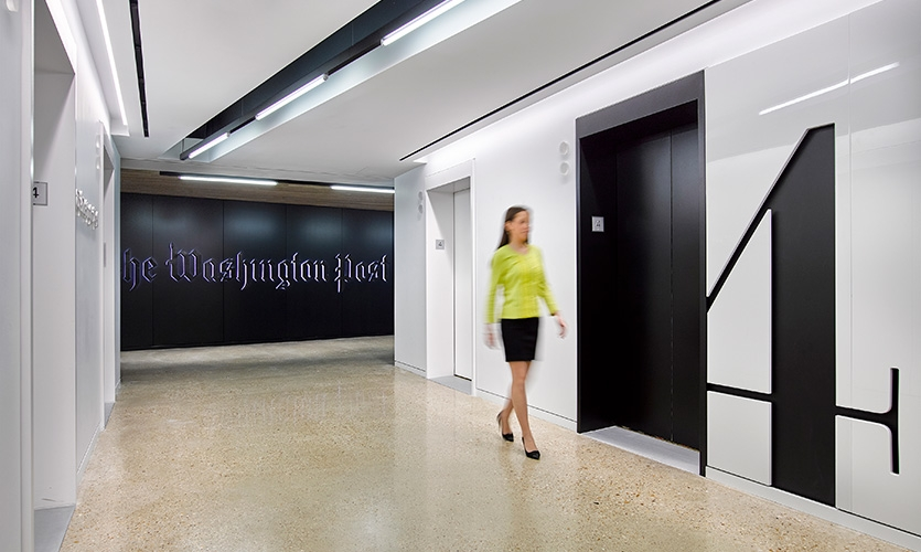 Floor identifications are set in Postoni—the Post's custom version of Bodoni—are carved into each white lacquer elevator bank to reveal the black drywall beneath.